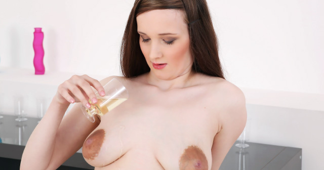 Nancy likes pouring piss over her tits