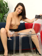 Gorgeous Carrie pisses on a glass chair