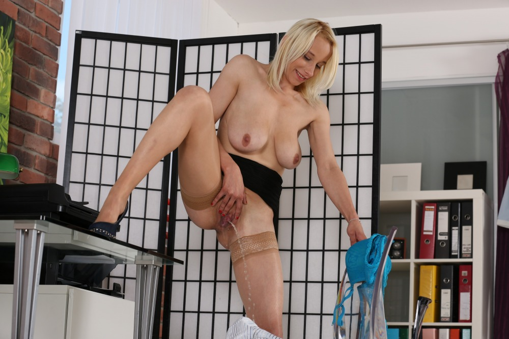 Big boobed blonde toys her pussy and pisses