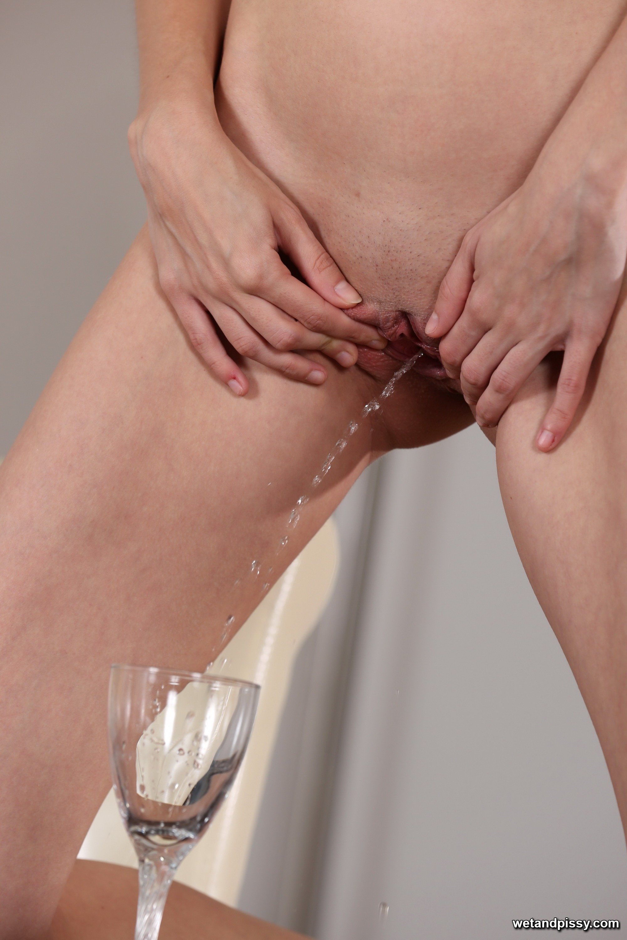 Ria toys her ass during piss play scene