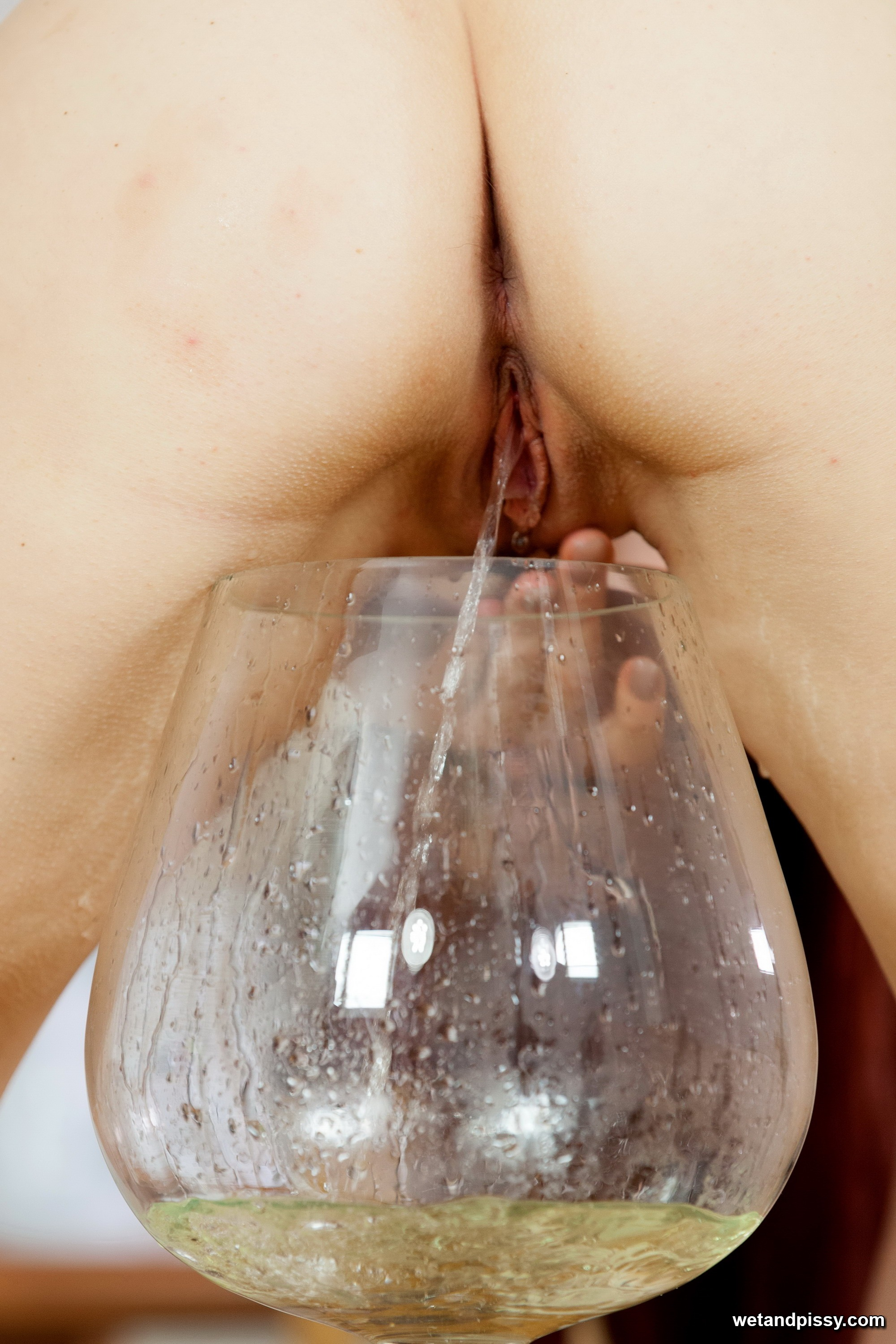 Teen redhead pisses into a giant goblet