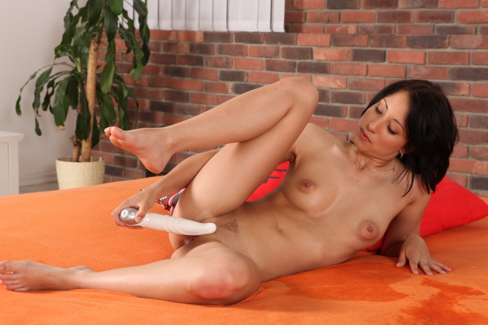 Horny brunette pees and uses toys on her twat