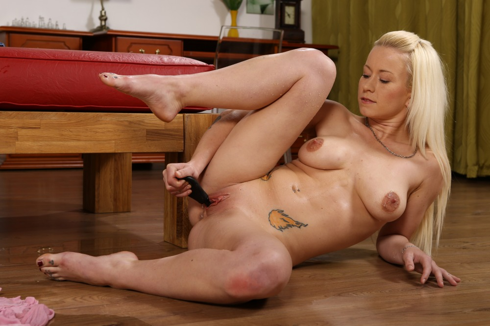 Hot blonde pees into a goblet and fucks her pussy